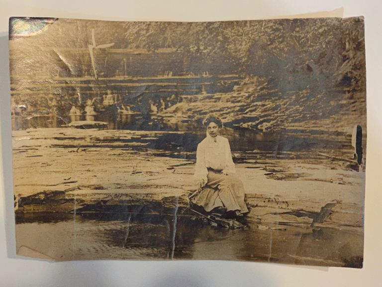 [DREAMY SILVER PRINT PHOTOGRAPH ca. 1910]. Woman seated on a river bank. Silver print photograph.