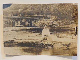 [DREAMY SILVER PRINT PHOTOGRAPH ca. 1910]. Woman seated on a river bank