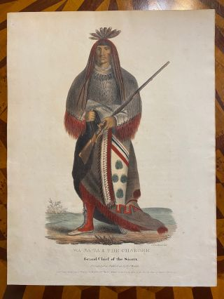 """[NATIVE AMERICAN PORTRAIT]. """"Wa-Na-Ta. The Charger, Grand Chief of the Sioux."""" Hand-colored lithograph from a folio edition of McKenney and Hall's Indian Tribes of North America"""